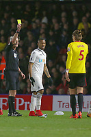 Referee Martin Atkinson shows a yellow card to Sebastian Prodl of Watford for his foul on Nathan Dyer of Swansea City during the Premier League match between Watford and Swansea City at the Vicarage Road, Watford, England, UK. Saturday 30 December 2017