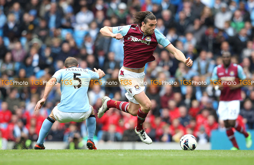 Andy Carroll of West Ham skips past Pablo Zabaleta of Man City - Manchester City vs West Ham United, Barclays Premier League at the Etihad Stadium, Manchester - 27/04/13 - MANDATORY CREDIT: Rob Newell/TGSPHOTO - Self billing applies where appropriate - 0845 094 6026 - contact@tgsphoto.co.uk - NO UNPAID USE.