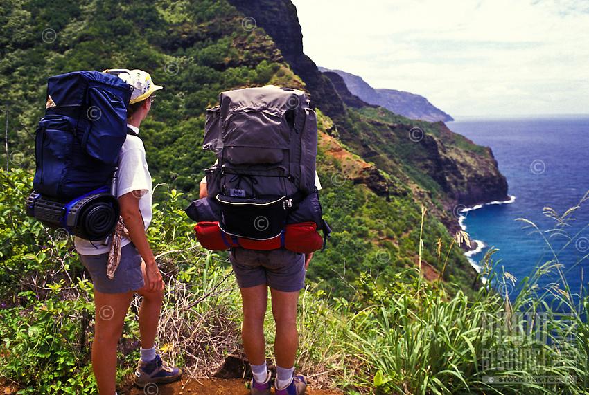 Backpackers on the dramatic Kalalau trial, Na Pali coast, Island of Kauai.