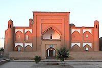 Arab Muhammad Khan (Arabkhan) Madrasah, 1616-1838), Khiva, Uzbekistan, pictured on July 06, 2010, at dawn. The one-yard, two storey Madrasah has a main entrance marked by a strict portal with cylinder-shaped guldasta towers with arched lanterns at the corner. Khiva, ancient and remote, is the most intact Silk Road city. Ichan Kala, its old town, was the first site in Uzbekistan to become a World Heritage Site(1991). Picture by Manuel Cohen.