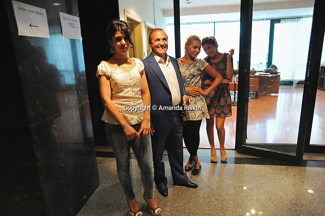 Ibrahim Ibrahimov (second from left) with his girls, the secretaries in his office, in the hallway at Avesta Concern on Teymur Aliyev Street, known locally as the Oligarchs' Street, in Baku, Azerbaijan on August 16, 2012.