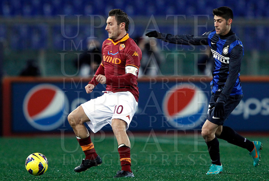 Calcio, semifinale di andata di Coppa Italia: Roma vs Inter. Roma, stadio Olimpico, 23 gennaio 2013..AS Roma forward Francesco Totti is chased by FC Inter midfielder Marco Benassi during the Italy Cup football semifinal first half match between AS Roma and FC Inter at Rome's Olympic stadium, 23 January 2013..UPDATE IMAGES PRESS/Isabella Bonotto