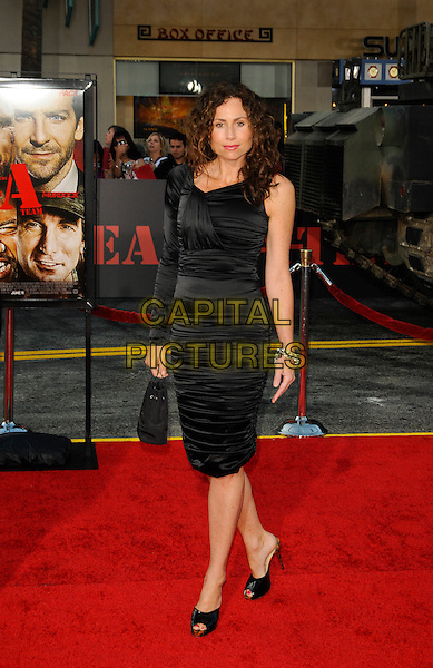 """MINNIE DRIVER .arriving at the  20th Century Fox premiere of """"The A-Team"""" at Grauman's Chinese Theatre in Hollywood, California, USA, June 3rd 2010..full length black dress on sleeve ruched peep toe shoes platform bag shoulder .CAP/ROT.©Lee Roth/Capital Pictures"""