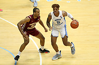 CHAPEL HILL, NC - FEBRUARY 1: Armando Bacot #5 of the University of North Carolina is defended by Steffon Mitchell #41 of Boston College during a game between Boston College and North Carolina at Dean E. Smith Center on February 1, 2020 in Chapel Hill, North Carolina.