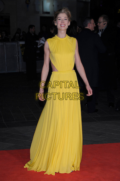 Rosamund Pike.'Jack Reacher' world film premiere Odeon cinemas, Leicester Square, London, England..10th December 2012.full length sleeveless dress cut out away yellow .CAP/PL.©Phil Loftus/Capital Pictures.