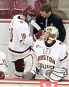Bert Lenz (BC - Director-Sports Medicine) checks on Danny Linell (BC - 10) who left the game. - The Boston College Eagles defeated the visiting University of Connecticut Huskies 3-2 on Saturday, January 24, 2015, at Kelley Rink in Conte Forum in Chestnut Hill, Massachusetts.
