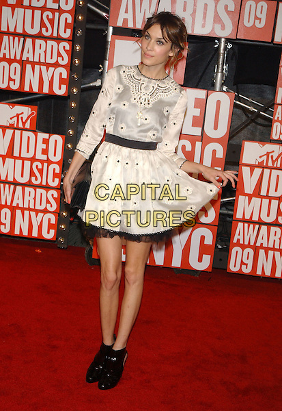 ALEXA CHUNG.2009 MTV Video Music Awards arrivals held at Radio City Music Hall, New York, NY, USA..September 13th, 2009.full length black dress white ankle boots clutch bag hand holding silk satin.CAP/ADM/MJ.©Michael Jade/AdMedia/Capital Pictures.