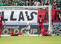 CHARLOTTE, NC - JUNE 23: Anibal Alvarez #13, Daniel Morejon #5, Jorge Kindelan #19 and Alejandro Portal #8 look on as Junior Hoilett #10 scores a goal during a game between Cuba and Canada at Bank of America Stadium on June 23, 2019 in Charlotte, North Carolina.