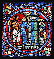The younger son, half naked and with a gesture of poverty, talks to a courtesan outside a house, from the Parable of the Prodigal Son stained glass window, in the north transept of Chartres Cathedral, Eure-et-Loir, France. This window follows the parable as told by St Luke in his gospel. It is thought to have been donated by courtesans, who feature in 11 of the 30 sections. Chartres cathedral was built 1194-1250 and is a fine example of Gothic architecture. Most of its windows date from 1205-40 although a few earlier 12th century examples are also intact. It was declared a UNESCO World Heritage Site in 1979. Picture by Manuel Cohen