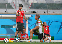 Germany coach Joachim Loew gestures as he talks with Bastian Schweinsteiger of Germany during training ahead of tomorrow's semi final vs Brazil