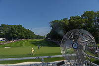 Jason Day (AUS) and Keegan Bradley (USA) wait for Phil Mickelson (USA) to hit on to 15 as a fan blows mist onto fans in the stadium seating during 1st round of the 100th PGA Championship at Bellerive Country Cllub, St. Louis, Missouri. 8/9/2018.<br /> Picture: Golffile | Ken Murray<br /> <br /> All photo usage must carry mandatory copyright credit (© Golffile | Ken Murray)