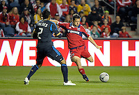 Chicago Fire defender Dan Gargan (3) sends in a cross while being defended by Philadelphia Union defender Carlos Valdes (2).  The Chicago Fire defeated the Philadelphia Union 1-0 at Toyota Park in Bridgeview, IL on March 24, 2012.