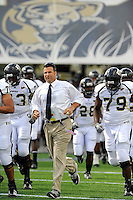 31 October 2009:  FIU Head Coach Mario Cristobal leads his team onto the field prior to the FIU Golden Panthers victory over the Louisiana-Lafayette Ragin' Cajuns, 20-17, in overtime at FIU Stadium in Miami, Florida.