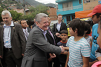 President of Germany Joachim Gauck while he visit the comuna nororiental Neighborhood In  Medellin, May 11, 2013. by Fredy Builes / VIEWpress