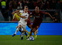Steven Nzonzi of AS Roma and Marcos Llorente of Real Madrid  during the Champions League Group  soccer match between AS Roma - Real Madrid  at the Stadio Olimpico in Rome Italy 27 November 2018