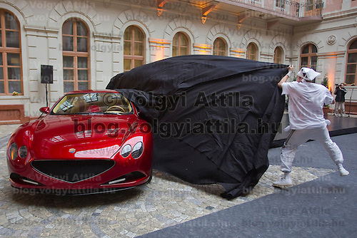Dancer uncovers the manually assembled Farralli & Mazzanti Vulca S luxury sports car to be produced in a limited series of ten pieces designed by Hungarian designer Zsolt Tarnok. Budapest, Hungary. Tuesday, 22. June 2010. ATTILA VOLGYI