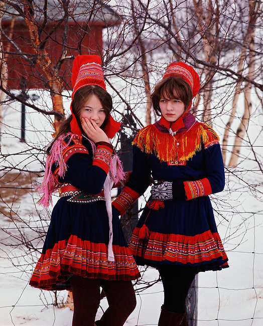 Young Saami girls in traditional costume outside the church. Kautokeino. Norway.