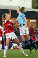 Gemma Bonner of Manchester City Women heads clear under pressure from Vivianne Miedema of Arsenal Women during Arsenal Women vs Manchester City Women, FA Women's Super League Football at Meadow Park on 11th May 2019