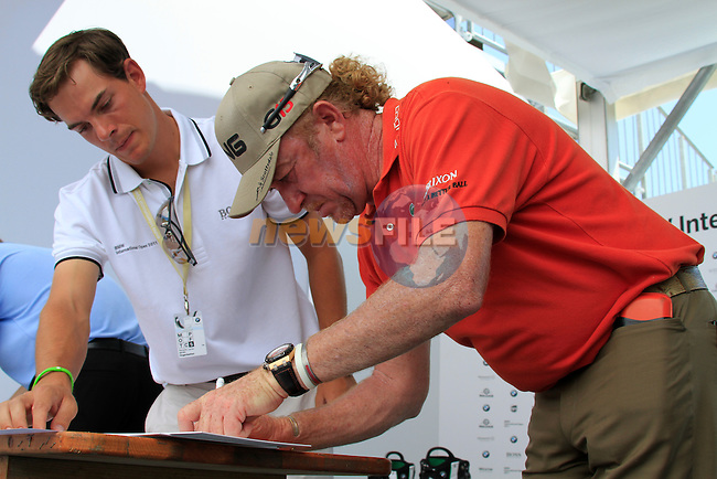 Miguel Angel Jimenez (ESP) signs jerseys after finishing his round in the Pro-Am Day of the BMW International Open at Golf Club Munchen Eichenried, Germany, 22nd June 2011 (Photo Eoin Clarke/www.golffile.ie)