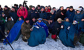 Expedition 29 Commander Mike Fossum, left, Flight Engineers Sergei Volkov, center, and Satoshi Furukawa, sit in chairs outside the Soyuz TMA-02M Capsule just minutes after they landed in a remote area outside the town of Arkalyk, Kazakhstan, on Tuesday, November 22, 2011. NASA Astronaut Fossum, Russian Cosmonaut Volkov and JAXA (Japan Aerospace Exploration Agency) Astronaut Furukawa are returning from more than five months onboard the International Space Station where they served as members of the Expedition 28 and 29 crews. .Mandatory Credit: Bill Ingalls / NASA via CNP