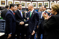 TALLAHASSEE, FLA. 3/4/14-Gov. Rick Scott, center, greets Sen. Andy Gardiner, R-Orlando, Senate President Designate, and Rep. Steve Crisafulli, R-Merritt Island, House Speaker Designate, left, as he enters the House Chamber for the State of the State address on the opening day of the legislative session, March 4, 2014 at the Capitol in Tallahassee.<br /> <br /> COLIN HACKLEY PHOTO