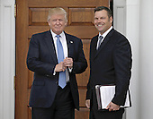 United States President-elect Donald Trump (L) and Kris Kobach Kansas Secretary of State pose at the clubhouse of Trump International Golf Club, in Bedminster Township, New Jersey, USA, 20 November 2016.<br /> Credit: Peter Foley / Pool via CNP