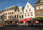 Historic buildings people sitting outside cafes central Utrecht, Netherlands