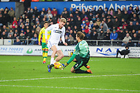 Oli McBurnie of Swansea City is tackled by Tim Krul of Norwich City during the Sky Bet Championship match between Swansea City and Norwich City at the Liberty Stadium, Swansea, Wales, UK. Saturday 24 November 2018