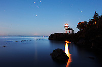 Lime Kiln Lighthouse stands watch over Haro Strait under a starry sky, Washington