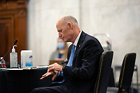 United States Senator Rick Scott (Republican of Florida) cleans his hands during a U.S. Senate Committee on Homeland Security and Governmental Affairs meeting in the Senate Russell Office Building in Washington D.C., U.S., on Wednesday, May 20, 2020, to consider a motion to issue a subpoena to Blue Star Strategies.  Credit: Stefani Reynolds / CNP/AdMedia