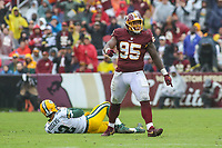 Landover, MD - September 23, 2018: Washington Redskins defensive tackle Da'Ron Payne (95) celebrates after sacking Green Bay Packers quarterback Aaron Rodgers (12) during the  game between Green Bay Packers and Washington Redskins at FedEx Field in Landover, MD.   (Photo by Elliott Brown/Media Images International)