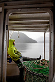 CANADA, Vancouver, British Columbia, Deck Hand Peter Chaucer rests in between pulling in Spotted Prawns pots on the boat Organic Ocean