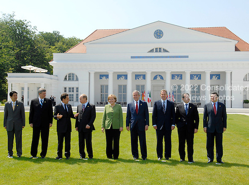 Heiligendamm, Germany - June 7, 2007 -- The G-8 Heads of State and Government pose pose for the summit official photograph in Heiligendamm, Germany on Thursday, June 7, 2007.  From left to right: Prime Minister Shinzo Abe of Japan, Prime Minister Stephen Harper of Canada, President Nicolas Sarkozy of France, President Vladimir Putin of Russia, Chancellor Angela Merkel of Germany, United States George W. Bush, Prime Minister Tony Blair of Great Britain, Prime Minister Romano Prodi of Italy, and European Union President José Barroso..Mandatory Credit: BPA via CNP.