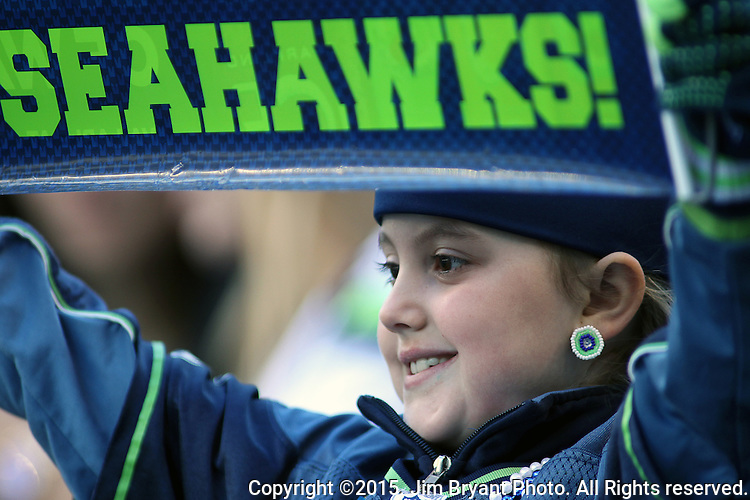 A Seattle Seahawks fans cheers her team on against the San Francisco 49ers at CenturyLink Field in Seattle, Washington on November 22, 2015.  The Seahawks beat the 49ers 29-13.   ©2015. Jim Bryant Photo. All RIghts Reserved.