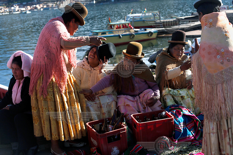 Women sit on the key as the Bolivian Navy march mourn the day they lost their ocean to Chile in the War of the Pacific. Bolivia lost what is now northern Chile in a war over nitrates leaving Bolivia without access to the ocean.