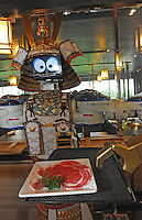 Samurai robot waiter serving food in the Hajime Restaurant, out-skirts of Bangkok, Thailand. Hajime is a Japanese restaurant in Thailand, has samurai style robot serving food to the diners and even do a dance session to entertain guests. This robot are made in Japan and costed about 86,600,000 yen (1,063,717USD). Customers order food from touch panel and Samurai robot will bring ordered food to their table.<br />