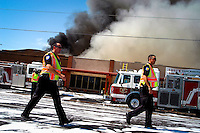 AJ ALEXANDER/AAP - Richardson's Restaurant is a well know Valley restaurant in central Phoenix, goes up in flames and smoke that started some time after 2 p.m.  on this 113 degree day. The stip mall is located on Bethany Home Rd. & 16th St. Friday July 17, 2009.  Photo by AJ Alexander