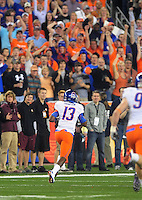 Jan. 4, 2010; Glendale, AZ, USA; Boise State Broncos cornerback (13) Brandyn Thompson returns an interception for a touchdown in the first quarter against the TCU Horned Frogs in the 2010 Fiesta Bowl at University of Phoenix Stadium. Mandatory Credit: Mark J. Rebilas-