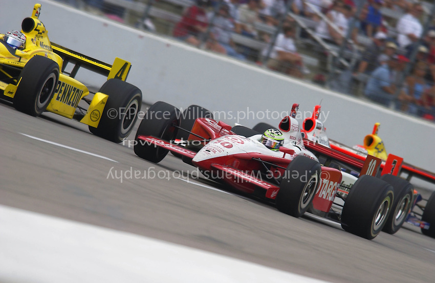 .Tomas Scheckter (10)  moves to the inside through the tri-oval....