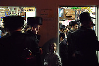 "USA. Brooklyn. 12th October 2006..A Sukkah in Brooklyn. The festival of Sukkot (Festival of Booths) concludes with a prayer recited upon leaving the sukkah (booth): ""May it be your will, Lord our God and God of our forefathers, that just as I have fulfilled and dwelled in this sukkah, so may I merit in the coming year to dwell in the sukkah of the skin of Leviathan. Next year in Jerusalem."".©Andrew Testa"