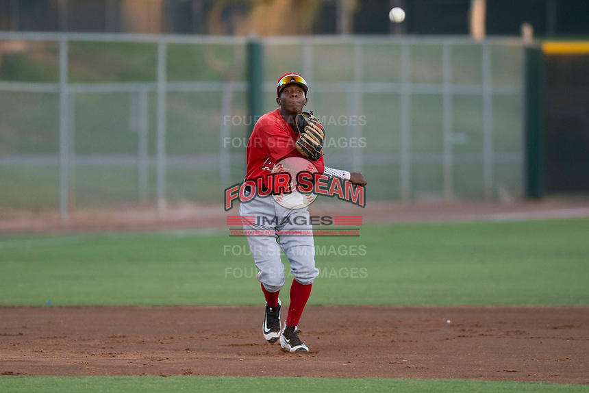 AZL Angels third baseman Daniel Ozoria (23) throws to first base during an Arizona League game against the AZL Giants Black at the San Francisco Giants Training Complex on July 1, 2018 in Scottsdale, Arizona. The AZL Giants Black defeated the AZL Angels by a score of 4-2. (Zachary Lucy/Four Seam Images)
