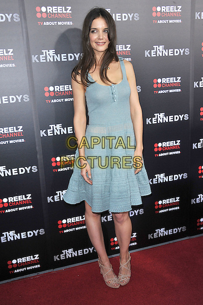 "KATIE HOLMES.attending the World Premiere of ""The Kennedys"" at The Academy of Motion Pictures Arts And Sciences, Samuel Goldwyn Theater in Beverly Hills, California, USA, March 28th, 2011..full length knitted dress beige nude strappy sandals green blue  buttons vest sleeveless  S initial necklace gold letter                                                                 .CAP/RKE/DVS.©DVS/RockinExposures/Capital Pictures."