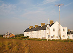 Row of white houses, Coastguard Cottages, at Shingle Street, Suffolk, England