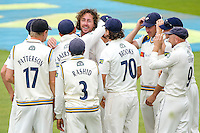 Picture by Alex Whitehead/SWpix.com - 12/09/2014 - Cricket - LV County Championship Div One - Nottinghamshire CCC v Yorkshire CCC, Day 4 - Trent Bridge, Nottingham, England - Yorkshire's Ryan Sidebottom is congratulated on the wicket of Notts' Chris Read.