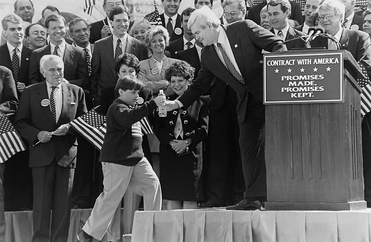 House Minority Whip Rep. Newt Gingrich, R-Ga., receiving water from a child in the crowd at the Contract of America rally at the end of the 1st 100 day of GOP controlled Congress in April 1994. (Photo by Maureen Keating/CQ Roll Call via Getty Images)