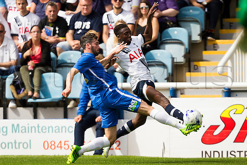 18.07.2015.  Peterborough, Engand. Pre Season Friendly Peterborough United versus Tottenham Hotspur. Joe Gormley (Peterborough United) stretches for the ball with Emmanuel Sonupe (Tottenham Hotspur).