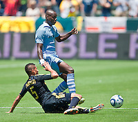 CARSON, CA – July 24, 2011: Sean Franklin (5) of LA Galaxy and Mario Balotelli (45) of Manchester City during the match between LA Galaxy and Manchester City FC at the Home Depot Center in Carson, California. Final score Manchester City FC 1 and LA Galaxy 1. Manchester City wins shoot out 7, LA Galaxy 6.