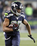 Seattle Seahawks wide receiver Doug Baldwin runs after catching a 33 yard pass from quarterback Russell Wilson against the Arizona Cardinals at CenturyLink Field in Seattle, Washington on November 15, 2015. The Cardinals beat the Seahawks 39-32.   ©2015. Jim Bryant photo. All Rights Reserved.
