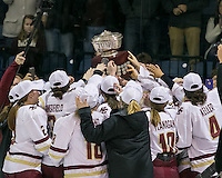 North Andover, Massachusetts - March 6, 2016: NCAA Division I, Women's Hockey East final. Boston College (white/maroon) defeated Boston University (red), 5-0, at Lawler Arena at Merrimack College. Boston College has a perfect Hockey East season - regular season, Bean Pot winner, and Women's Hockey East winner. Boston College team hoists the Women's Hockey East Cup.
