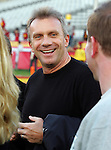 Los Angeles, CA 11/25/06 - Joe Montana chats it up with Notre Dame Football staffers before the USC-Notre Dame game at the Los Angeles Colisseum.<br />
